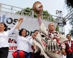 Leftist front-runner Andres Manuel Lopez Obrador waves to supporters during a campaign rally in in Michoacan state, Mexico.