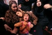Relatives of Palestinian Haytham Al-Jamal, 15, mourn during his funeral in Rafah in the southern Gaza Strip.