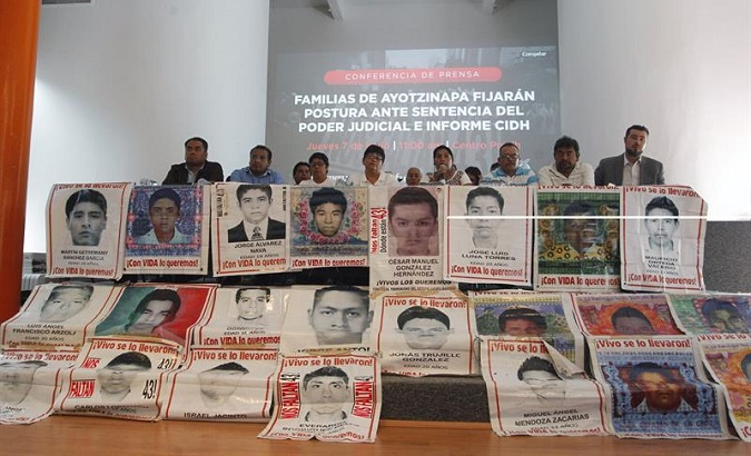 Relatives of the missing students during a press conference regarding a tribunal's decision to create an independent investigation commission over the case. Mexico City, June 7, 2018.