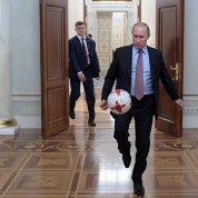Russian President Vladimir Putin plays with a ball following a meeting with FIFA President Gianni Infantino at the Kremlin in Moscow, Russia.