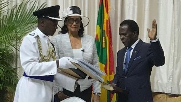 Cécile La Grenade, center, the Governor-General of Grenada, swears in Dr. Keith Mitchell, right, as the Prime Minister of Grenada in March.