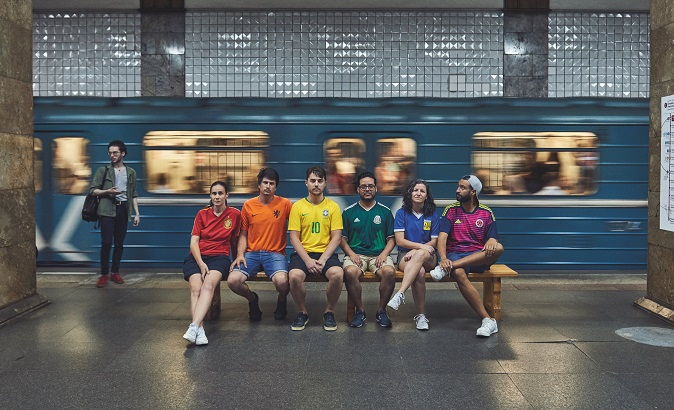 Gay rights activists, wearing soccer jerseys to form a rainbow flag, walk in Moscow's Red Square as they visit Russia during the World Cup, photo obtained by Reuters on July 10, 2018.