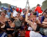 France fans celebrate in front of the Eiffel Tower after France win the 2018 World Cup.
