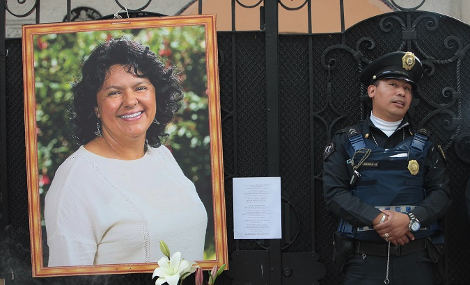 A portrait of Berta Caceres in front of the Honduran Embassy in Mexico City during a protest demanding justice, June 2016.