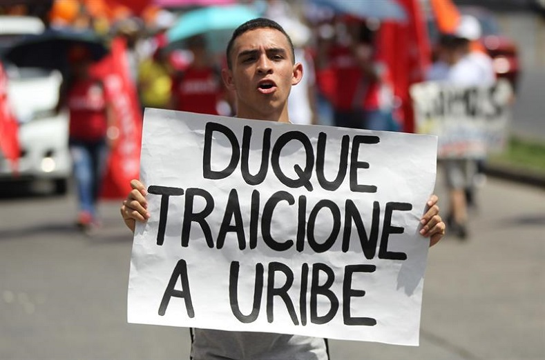 Many consider Ivan Duque a frontman for former right-wing Colombian President Alvaro Uribe, who