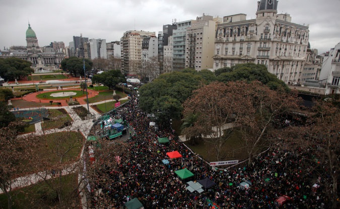 Pro-abortion demonstrators take part in a protest in front of National Congress while an abortion bill is debated in Buenos Aires