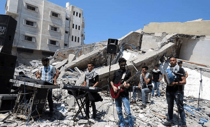 Palestinian musicinas perform on the ruins of Gaza's Said al-Mishal Cultural Center.