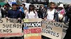Students in Ecuador protesting against government's fund cut in education.