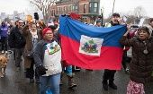 Haitian immigrants protest Trump immigration policies against TPS and DACA recipients.