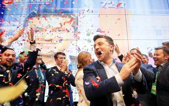 Ukrainian presidential candidate Volodymyr Zelenskiy reacts following the announcement of the first exit poll in a presidential election at his campaign headquarters in Kiev, Ukraine April 21, 2019.