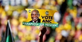 A supporter holds a placard of Cyril Ramaphosa in Johannesburg, South Africa, May 5, 2019.