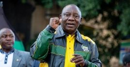 South African President Cyril Ramaphosa greets African National Congress supporters outside the party headquarters.