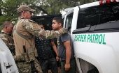 Members of the Border Patrol Search, Trauma, and Rescue Unit near Falfurrias, Texas, apprehend an immigrant from Guatemala June 19.