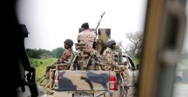 A Nigerian army convoy vehicle drives ahead with an anti-aircraft gun, on its way to Bama, Borno State, Nigeria August 31, 2016.