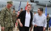 US Southern Command head Craig Faller (L), US Businesses charge Heide Fulton (C), President Juan Orlando Hernandez (R) in Tegucigalpa, Honduras, June 21, 2019.