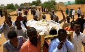 Locals and relatives of three Sudanese men riddled with bullets chant slogans as they carry one of the corpses in the city of Omdurman across the River Nile from Khartoum, Sudan, July 1, 2019.