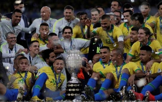 Brazil players celebrate winning the Copa America with the trophy.