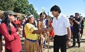 Evo Morales greets supporters at