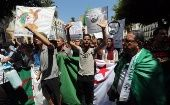 Algerian protesters shout slogans and carry the national flag during a demonstration in Algiers, Algeria, 23 July 2019.