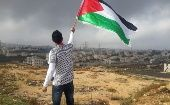 Palestinian raising the country