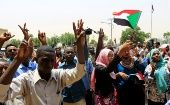 Sudanese people celebrate the signing of the constitutional declaration.