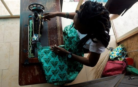 A woman works as a tailor after training with the support of Nigerian charity Pathfinders Justice Initiative in Benin City, Nigeria July 20, 2019.
