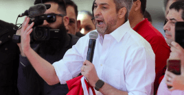 Paraguay's President Mario Abdo Benitez gestures as he meets supporters in Asuncion, Paraguay, August 13, 2019.