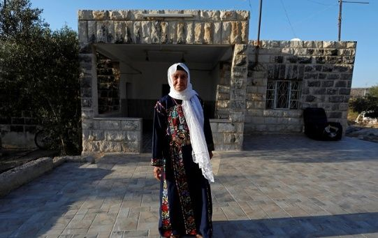 Muftia, the grandmother of U.S. congresswoman Rashida Tlaib, poses for a photo in front of her house in the village of Beit Ur Al-Fauqa in the Israeli-occupied West Bank August 16, 2019. Picture taken August 16, 2019.