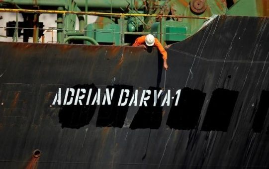 A crew member takes pictures with a mobile phone to Iranian oil tanker Adrian Darya 1, before being named as Grace 1.