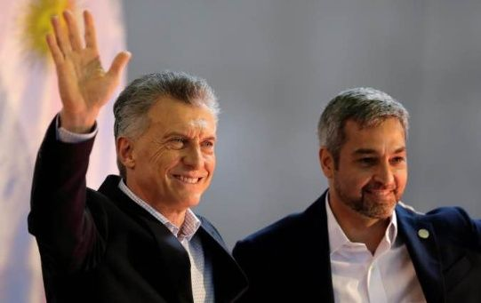 Paraguay's President Mario Abdo Benitez and his Argentine counterpart Mauricio Macri attend a ceremony in Ayolas