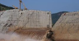 FILE PHOTO: Water flows through Ethiopia's Grand Renaissance Dam as it undergoes construction work on the river Nile in Guba Woreda, Benishangul Gumuz Region, Ethiopia September 26, 2019.