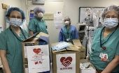 Medical workers pose for a photo with donated medical supplies at a hospital in Staten Island of New York, the United States, on March 29, 2020.