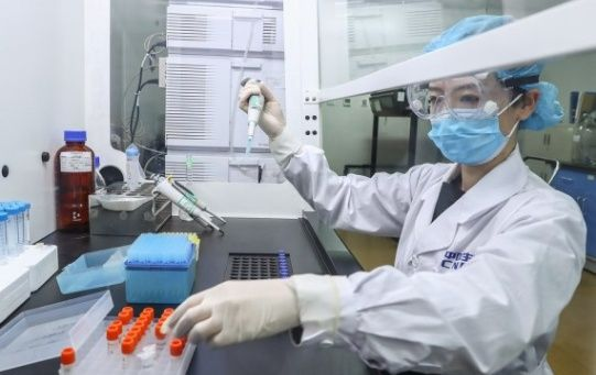A staff member tests samples of the COVID-19 inactivated vaccine at a vaccine production plant of China National Pharmaceutical Group (Sinopharm) in Beijing, capital of China, April 11, 2020.