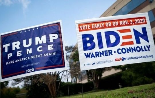 Two banners promote the nominations of Donald Trump and Joe Biden, Washington, U.S., Oct. 20, 20